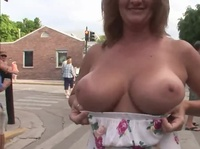 Amazing milf shows off her luscious hooters to anyone
