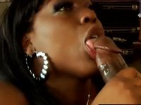 Chocolate ice cream melts in her lusty mouth