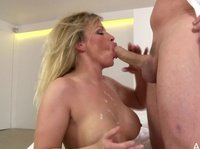 Hot blonde mama gobbles on her dessert