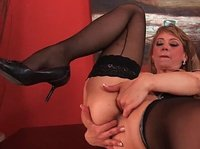 Mature blonde fingers her maroon red pussy hole