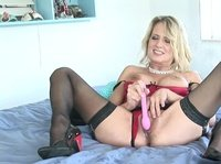 Sexy mom brings out her pink dildo