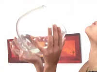Delicious blonde pees in a huge glass