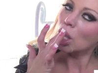 Leather bitch licks her cum covered fingers