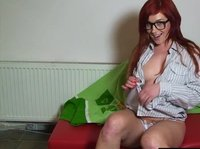 Redhaired nerd plays with her amazing dildo