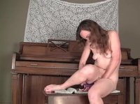 Young redhead toys her very hairy pussy