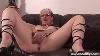 Mature lady reaches between her legs