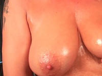 Busty mom plays with her oiled slit