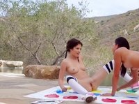 Barely legal babes play Twister in the park