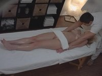 Young blonde gets all naked for massage
