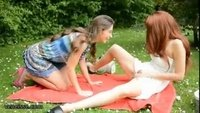 Lesbian cuties enjoy a day at the park