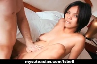 Asian cutie put out to a guy who wear a condom