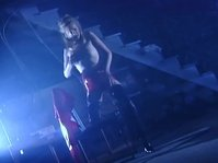 Exotic dancer in latex gets hot during her own performance
