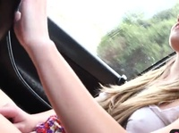 Young blonde plays with herself in her first car