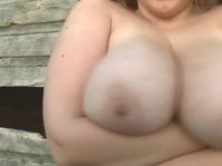 Chubby farm girl plays with her enormous tits