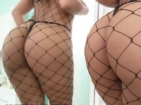 Greedy bitch in fishnet grabs two hard dicks