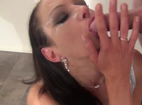Dark-haired sexy fox gobbles on a dick