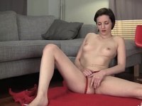 18 year old babe plays with her pussy on a red rug