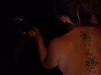 Tattooed bitch is getting it from behind in the dark