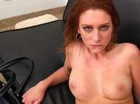 Young redhead in a tiny g-string is looking forward to having a mouthful