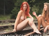Young naked elves pose on the rails