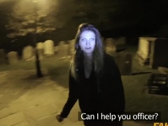 Police officer helps a girl lost in a graveyard