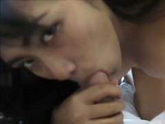 Totally naked Asian babe hungrily sucks a dick