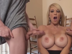 She uses her hot mouth to make them cum on her round tits
