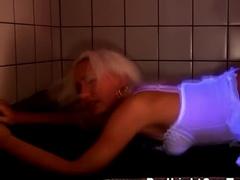 Blonde in stockings gets fucked under UV lights